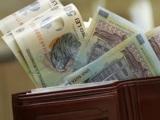 Vești bune pentru bugetari. Salariul minim brut va fi majorat anul viitor la 1.200 lei